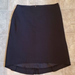 Lined black dress skirt with pleated back